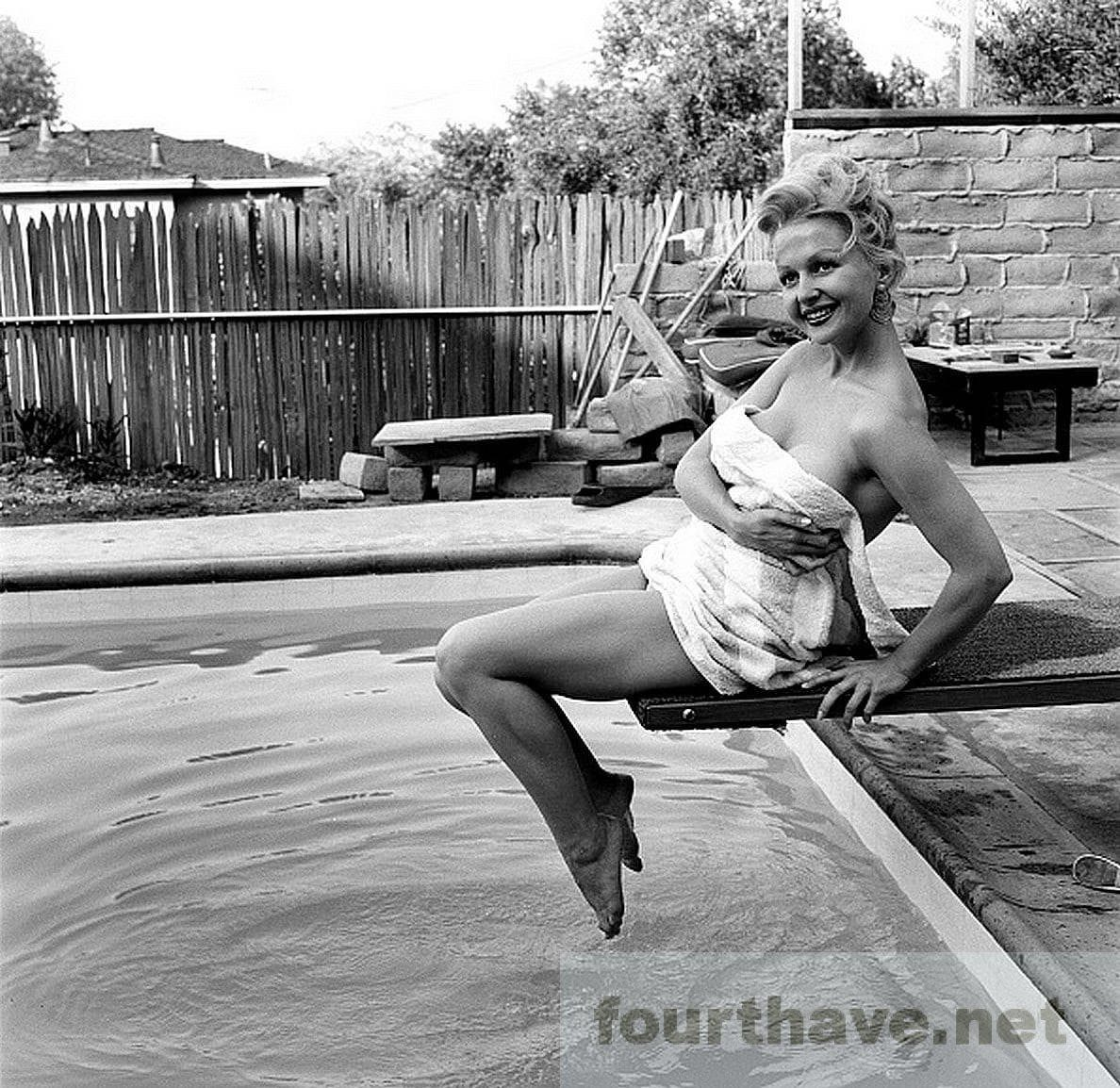 Greta Thyssen by the pool without a swim suit